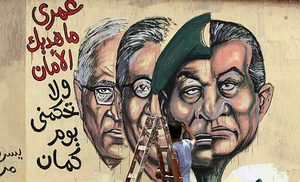 Graffiti of the morphed faces of Egyptian ousted president Hosni Mubarak (R) and military ruler Hussein Tantawi and presidential candidates Amr Mussa (C) and Ahmed Shafiq (L), Cairo'