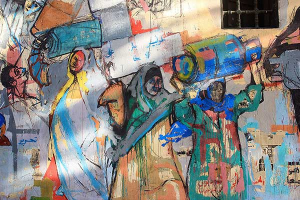"""""""Women with gas tanks"""" depicts the crisis of gas shortages in Egypt."""