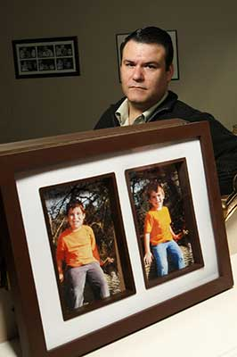 Stephen Watkins with photos of his missing sons, Alexander - Christopher Watkins Photo by - Rene Johnston Toronto Star