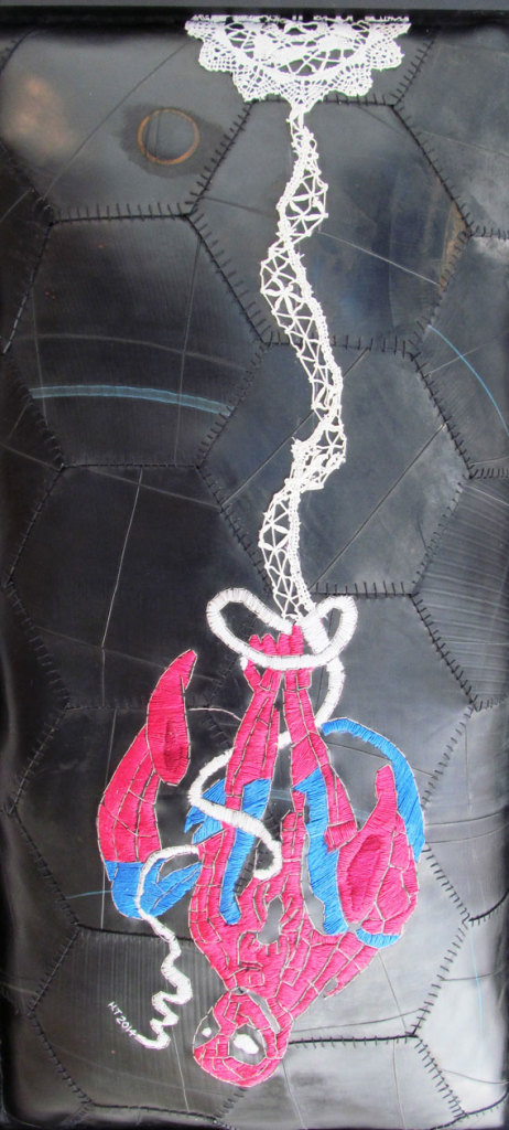 """Hannalie-Taute - Not part of the fairytale,  but hang in there"""" embroidery on rubber/inner tube"""