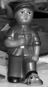 A-toy-Red-Guard-I-bought-in-1967-stamping-on-the-serpent's-head-of-Liu-Shaoqi-Mao's-enemy-Charmingly-it-squeaks-when-you-press-it