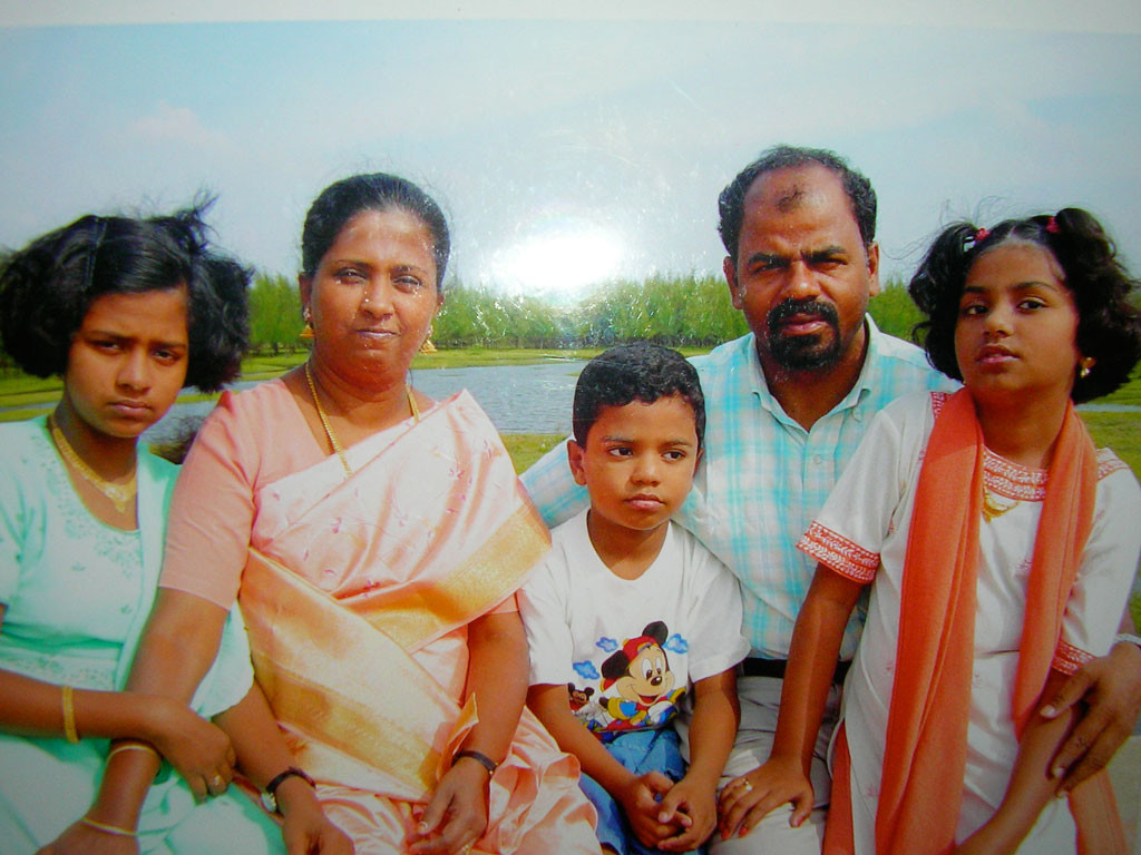 Mr Parmeshwaram with his wife and three children