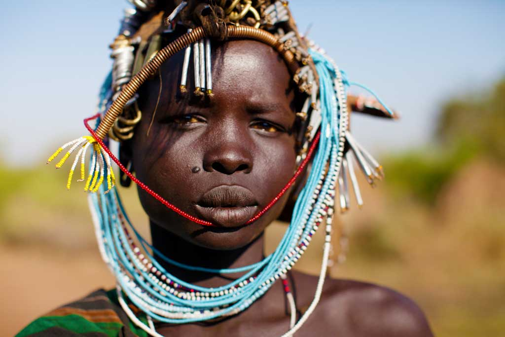 Mursi-woman--in-head-dress