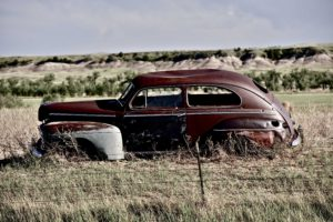 Clunker on Prairie near Pine Ridge Indian Reservation in South Dakota. Abandoned Car in South Dakota.