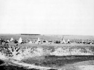 shutterstock_238816231-u-s-troops-surrounding-the-indians-on-wounded-knee-battle-field-miller-studio-gordon-nebraska-photograph-november-10-1913