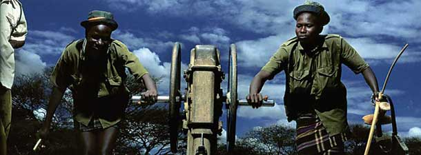 Courtesy of Alejandro Chaskielberg, Oxfam and Michael Happen Gallery Portrait of Napva Kaanvang and Losike. Kangwira collecting water for local women. Turkana Series 2011