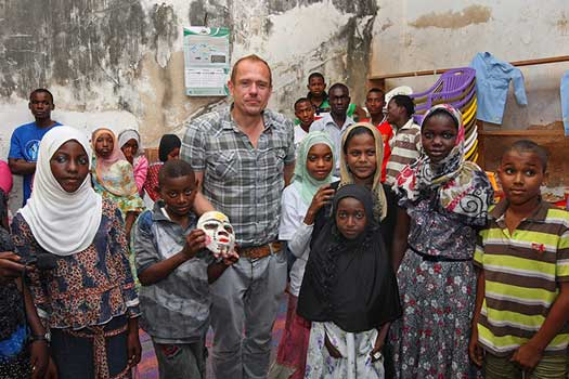 Gery Keszler in Zanzibar visiting a  Clinton Foundation project © Clemens Groh
