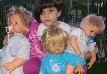 Girl with Cicciobello dolls