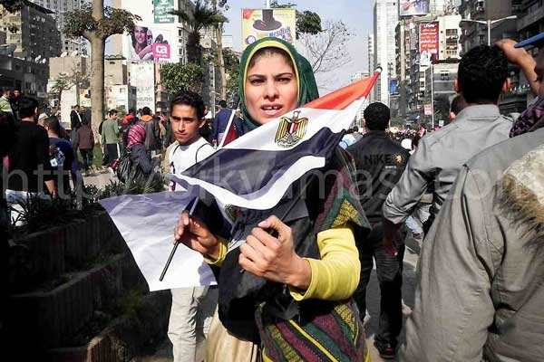 Woman holding Egyptian flag