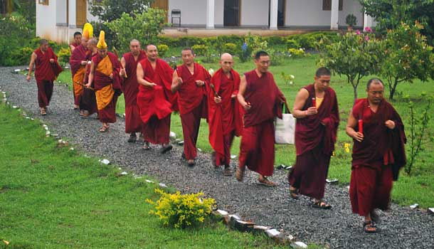 The monastery's officials lead Nicky to the temple