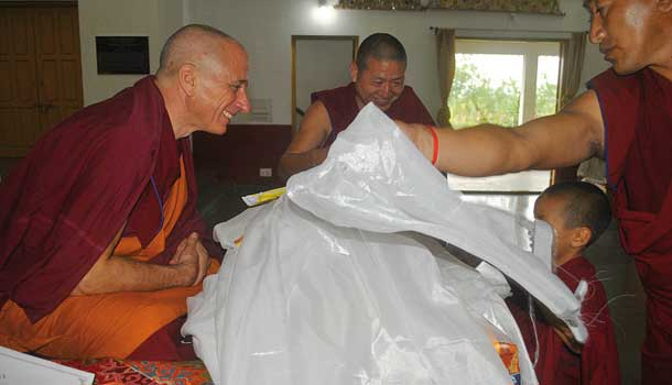 Monks offer white scarves