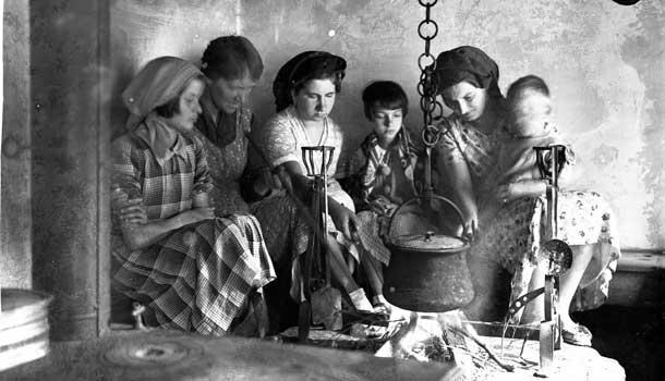 Ladies around cauldron