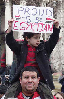 Boy holding board saying Proud to be Egyptian