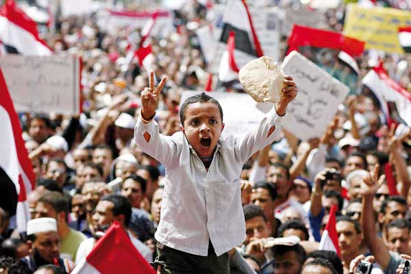 Boy with bread during Egyptian political revolution