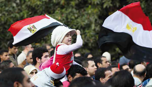 Girl holding flag during Egyptian revolution
