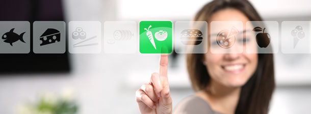 Woman choosing vegetables on a digital display