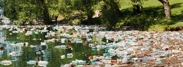 Lake with lots of plastic bottles in the water