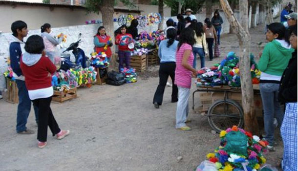 Sale of flowering and the entrance of the cemetery in Tilcara.