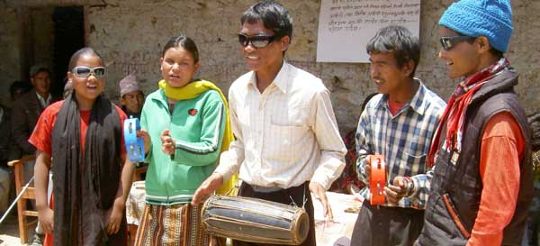 Blind musicians playing to a crowd